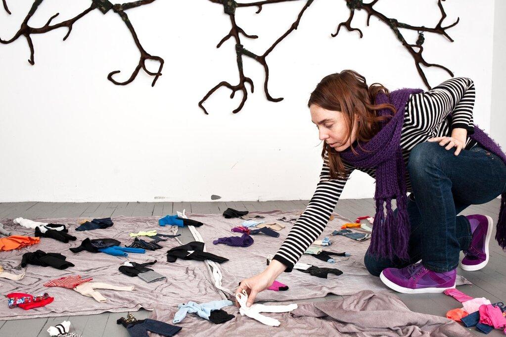 Julia Cseko arranging elements of art exhibit