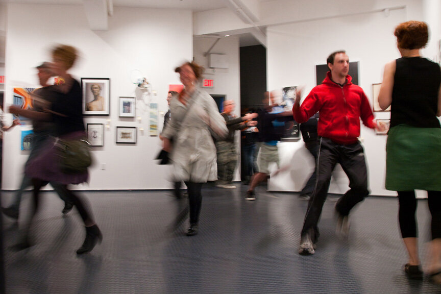 people running around a gallery