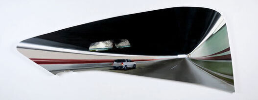 warped view of car in tunnel